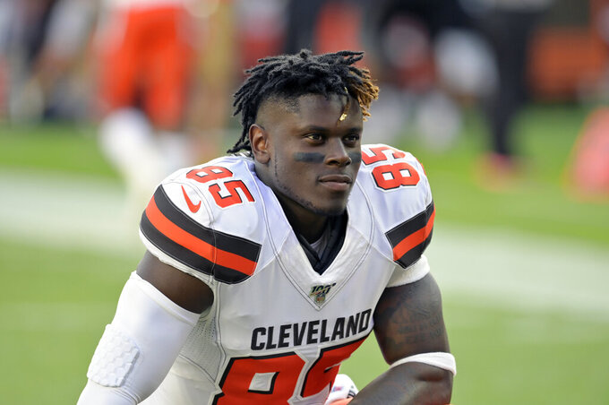 FILE - In this Aug. 8, 2019, file photo, Cleveland Browns tight end David Njoku kneels on the field before an NFL preseason football game against the Washington Redskins, in Cleveland. Njoku has returned to practice after missing eight games with a broken right wrist. Njoku was injured in Cleveland's win over the New York Jets on Sept. 16. The Browns designated Njoku for return from injured reserve on Wednesday, Nov. 20, 2019. (AP Photo/David Richard, File)