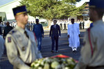 French President Emmanuel Macron arrives to pay tribute to French soldiers who died in Mali helicopter crash, Monday Jan.13, 2020 in Pau, southwestern France. France is preparing its military to better target Islamic extremists in a West African region that has seen a surge of deadly violence. (AP Photo/Alvaro Barrientos, Pool)