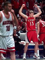 FILE - In this March 21, 1998, fie photo, Utah's Hanno Mottola celebrates as the final seconds run out in Utah's win over Arizona in the NCAA West Regional final at the Arrowhead Pond in Anaheim, Calif. Utah defeated Arizona 76-51. Nobody expected Utah to wallop reigning national champion and No. 1 seed Arizona when they met in the Elite Eight of the 1998 tournament. (AP Photo/Mark J. Terrill, File)