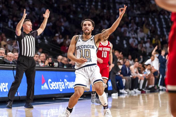 Georgia Tech guard Jose Alvarado (10) celebrates in the first half of an NCAA college basketball game against North Carolina State Saturday, Jan. 25, 2020, in Atlanta. (AP Photo/Danny Karnik)