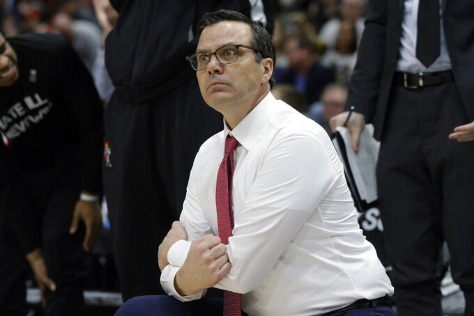 FILE - In this March 15, 2019, file photo, Nebraska head coach Tim Miles pauses as he argues a call during the second half of an NCAA college basketball game against Wisconsin in the quarterfinals of the Big Ten Conference tournament, in Chicago. Nebraska has fired seventh-year coach Tim Miles after the Cornhuskers finished 13th in the Big Ten and failed to make the NCAA Tournament for a fifth straight year. Athletic director Bill Moos announced the firing Tuesday, March 26, 2019, two days after the Huskers finished a 19-17 season with an 88-72 loss to TCU in the second round of the NIT.(AP Photo/Kiichiro Sato, File)