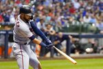 Minnesota Twins' Marwin Gonzalez hits a three-run home run during the eighth inning of a baseball game against the Milwaukee Brewers Tuesday, Aug. 13, 2019, in Milwaukee. (AP Photo/Morry Gash)