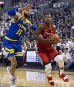 UNLV guard Amauri Hardy (3) drives the baseline against Nevada forward Cody Martin (11) during the first half of an NCAA college basketball game in Reno, Nev., Wednesday, Feb. 27, 2019. (AP Photo/Tom R. Smedes)