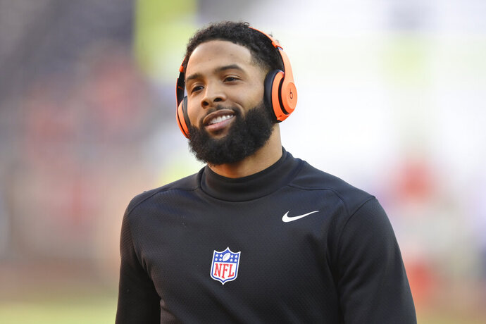 FILE - In this Dec. 22, 2019, file photo, Cleveland Browns wide receiver Odell Beckham Jr. reacts before an NFL football game against the Baltimore Ravens, in Cleveland. A misdemeanor simple battery warrant has been issued for Cleveland Browns wide receiver and former LSU star Odell Beckham Jr., police in New Orleans said Thursday, Jan. 16, 2020. The warrant comes as video posted on social media appears to show Beckham swatting a security officer's buttocks during LSU's locker room victory celebration after Monday night's college national championship game in the Superdome. (AP Photo/David Richard, File)