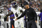 Baltimore Ravens head coach John Harbaugh motions to his players during the second half of an NFL football game against the Las Vegas Raiders, Monday, Sept. 13, 2021, in Las Vegas. (AP Photo/David Becker)