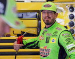 Kyle Busch cools himself off with an air hose in his garage during a NASCAR auto race practice at Daytona International Speedway, Thursday, July 4, 2019, in Daytona Beach, Fla. (AP Photo/Terry Renna)