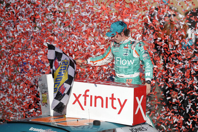 "FILE - In this Oct. 19, 2019, file photo, Brandon Jones celebrates in Victory Lane after winning a NASCAR Xfinity Series auto race at Kansas Speedway in Kansas City, Kan. NASCAR has signed Busch Beer, Coca-Cola, Geico and Xfinity as its ""premier partners"" in a change to its traditional sponsorship model. The premier series starting next year will be known as the NASCAR Cup Series and not feature a title sponsor.  (AP Photo/Orlin Wagner, File)"