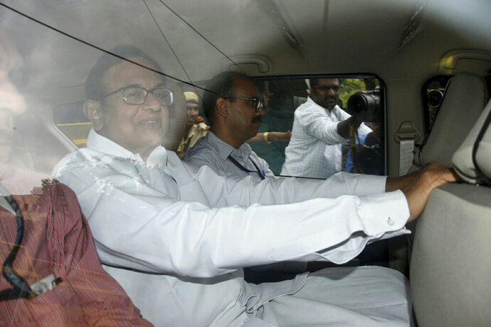 India's opposition Indian National Congress party leader   Palaniappan Chidambaram leaves the Central Bureau of Investigation headquarters to be produced before a court in New Delhi, India, Thursday, Aug. 22, 2019. Chidambaram was taken into custody on suspicion of conspiring with a Mauritius-based firm to illegally obtain money for his son's company while he was India's finance minister in 2006. (AP Photo/Dinesh Joshi)