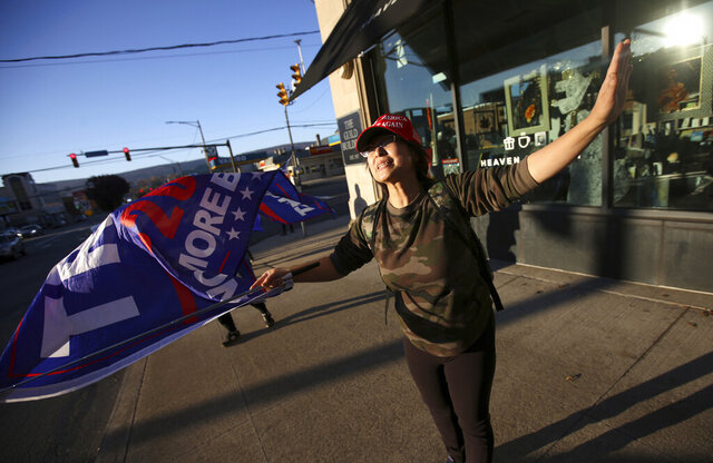 A woman shows her support for President Donald Trump on Monday, Nov. 9, 2020, in Scranton, Pa. (Jake Danna Stevens/The Times-Tribune via AP)