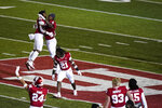 Indiana's Joseph Daniels Jr. (20), Cam Jones (4) and Noah Pierre (21) celebrate after Indiana defeated Penn State in overtime of an NCAA college football game, Saturday, Oct. 24, 2020, in Bloomington, Ind. (AP Photo/Darron Cummings)