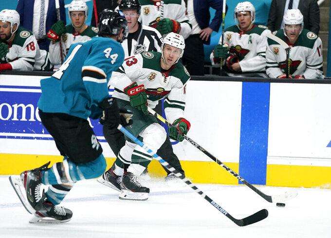 Minnesota Wild center Nick Bonino (13) skates down the ice against San Jose Sharks defenseman Marc-Edouard Vlasic (44) during the second period of an NHL hockey game in San Jose, Calif., Monday, Feb. 22, 2021. (AP Photo/Tony Avelar)