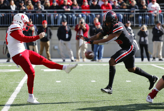 Ohio State linebacker Keandre Jones, right, blocks a punt by Nebraska punter Isaac Armstrong during the first half of an NCAA college football game Saturday, Nov. 3, 2018, in Columbus, Ohio. (AP Photo/Jay LaPrete)