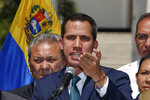 Opposition leader Juan Guaido, who has declared himself the interim president of Venezuela, speaks during a press conference on the steps of the National Assembly in Caracas, Venezuela, Monday, Feb. 4, 2019. Germany, Spain, France, the U.K. and Sweden have announced that they are recognizing Guaido as the country's interim president and are urging him to hold a new presidential election. (AP Photo/Fernando Llano)