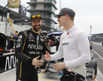 James Hinchcliffe, of Canada, talks with Josef Newgarden, right, before the final the warm up session for the IndyCar Grand Prix auto race at Indianapolis Motor Speedway in Indianapolis, Saturday, May 12, 2018. (AP Photo/Darron Cummings)