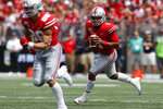 Ohio State quarterback Justin Fields looks for an open receiver against Florida Atlantic during the first half of an NCAA college football game Saturday, Aug. 31, 2019, in Columbus, Ohio. (AP Photo/Jay LaPrete)