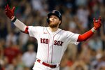 Boston Red Sox's Alex Verdugo celebrates his walk-off, RBI single during the ninth inning of a baseball game against the Cleveland Indians, Saturday, Sept. 4, 2021, in Boston. (AP Photo/Michael Dwyer)