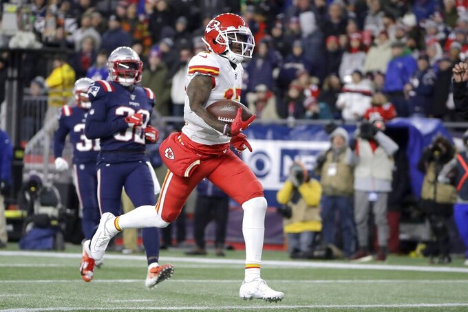 Kansas City Chiefs wide receiver Mecole Hardman runs for a touchdown after making a catch against the New England Patriots in the first half of an NFL football game, Sunday, Dec. 8, 2019, in Foxborough, Mass. (AP Photo/Steven Senne)