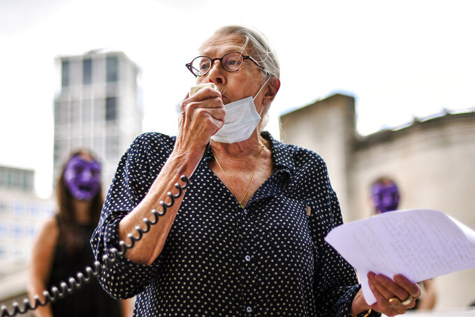 British Actress Vanessa Redgrave gives a speech as she joins the theatre workers protest outside the National Theatre, against the mass redundancies of low-paid art jobs due to the Coronavirus outbreak, in London, Saturday, Aug. 1, 2020. Prime Minister Boris Johnson put some planned measures to ease the U.K.'s lockdown on hold Friday, saying the number of new coronavirus cases in the country is on the rise for the first time since May. He called off plans to allow venues, including casinos, bowling alleys and skating rinks, to open from Saturday, Aug. 1. (AP Photo/Alberto Pezzali)