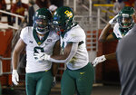 Baylor safety Jalen Pitre, left, celebrate his interception return for a touchdown with safety Christian Morgan, right, during the first half of an NCAA college football game against Iowa State, Saturday, Nov. 7, 2020, in Ames, Iowa. (AP Photo/Matthew Putney)