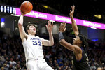 Xavier forward Zach Freemantle (32) rises for a shot as Western Carolina forward Xavier Cork (13) defends during the first half of an NCAA college basketball game, Wednesday, Dec. 18, 2019 in Cincinnati. (Kareem Elgazzar/The Cincinnati Enquirer via AP)