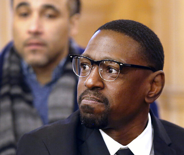 FILE - In this Wednesday, Feb. 14, 2018, file photo, Lamonte McIntyre, convicted of a 1994 double homicide in Kansas City, Kan., sits before the Senate Judiciary Committee where he urged them to approve a bill creating a compensation system in Kansas for people wrongfully convicted of crimes. Kansas is dropping its fight against the compensation claim from McIntyre. Attorney General Derek Schmidt said in an Associated Press interview Tuesday, Feb. 4, 2020, that his office reviewed an additional 900 pages of documents from McIntyre's attorney that had not been provided previously, and also said an ongoing Kansas Bureau of Investigation review of the 1994 crimes for which McIntyre, from Kansas City, Kansas, was charged turned up new information, which his office received only last week. (Thad Allton/The Topeka Capital-Journal via AP, File)