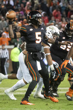 Miami quarterback N'Kosi Perry (5) throws a pass next to Georgia Tech defensive lineman Desmond Branch during the second half of an NCAA college football game Saturday, Nov. 10, 2018, in Atlanta. Georgia Tech won 27-21. (AP Photo/John Amis)