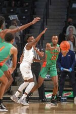 Florida A&M guard Jamir Williams (13) passes the ball against Georgia Tech during the first half of an NCAA college basketball game in Atlanta, Friday, Dec. 18, 2020. (Alyssa Pointer/Atlanta Journal-Constitution via AP)