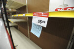 A raincheck notice for fans is posted on empty shelves at the True Value Hardware store, as people try to stay cool in the record breaking heat in Anchorage, Alaska, Friday, July 5, 2019. Alaskans who routinely pack knit caps and fleece jackets in summer on Friday were swapping them for sunscreen and parasols amid a prolonged heatwave. Residents of Anchorage and other south-central cities completed a fifth week of above-normal temperatures, including a record high 90 degrees (32.22 Celsius) on Thursday, in the state's largest city. (Anne Raup/Anchorage Daily News via AP)