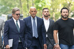 Tom Barrack, second left, arrives at Brooklyn federal court, Monday, July 26, 2021, in New York. Barrack was among three men charged in New York federal court with trying to influence foreign policy while Donald Trump was running in 2016 and later while president. The chair of former President Donald Trump's 2017 inaugural committee allegedly conspired to influence U.S. policy to benefit the United Arab Emirates, even while he was seeking a position as an American diplomat. (AP Photo/Mark Lennihan)