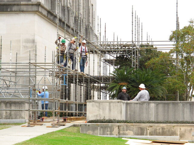 Workers erect scaffolding at the Louisiana Capitol on Thursday, Jan. 21, 2021, in Baton Rouge, La. A new phase of building repairs has started to replace mortar on the walls of the House and Senate chambers. (AP Photo/Melinda Deslatte)
