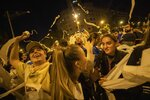 Catalan pro-independence demonstrators throw paper toilet rolls into the air during a protest in Barcelona Spain, Wednesday, Oct. 16, 2019. The Supreme Court found nine of 12 Catalan politicians and activists guilty of sedition and gave them prison sentences of nine to 13 years. Four of them were additionally convicted of misuse of public funds. The other three were fined for disobedience. (AP Photo/Bernat Armangue)