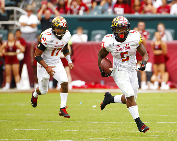 Maryland running back Anthony McFarland Jr. (5) runs with the ball during the second half of an NCAA college football against Temple, Saturday, Sept. 14, 2019, in Philadelphia. Temple won 20-17. (AP Photo/Chris Szagola)