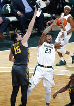 Michigan State's Xavier Tillman, right, and Iowa's Ryan Kriener (15) vie for a rebound during the second half of an NCAA college basketball game, Tuesday, Feb. 25, 2020, in East Lansing, Mich. Michigan State won 78-70. (AP Photo/Al Goldis)