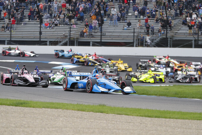 Felix Rosenqvist, of Sweden, leads the field on the start of the Indy GP IndyCar auto race at Indianapolis Motor Speedway, Saturday, May 11, 2019 in Indianapolis. (AP Photo/Michael Conroy)