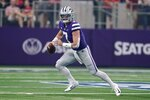 Kansas State quarterback Skylar Thompson (7) scrambles out of the pocket in the first half of an NCAA college football game against Stanford in Arlington, Texas, Saturday, Sept. 4, 2021. (AP Photo/Tony Gutierrez)