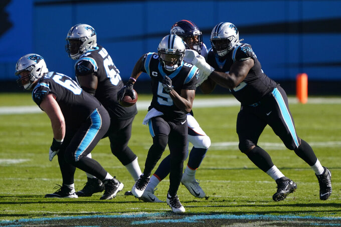 Carolina Panthers quarterback Teddy Bridgewater runs against the Denver Broncos during the first half of an NFL football game Sunday, Dec. 13, 2020, in Charlotte, N.C. (AP Photo/Brian Blanco)