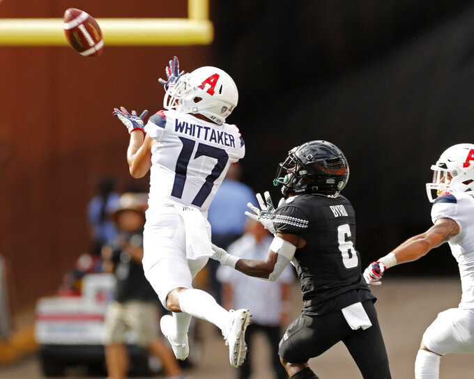 Arizona cornerback Jace Whittaker (17) makes an interception in front of Hawaii wide receiver Cedric Byrd II (6) during the first quarter of an NCAA college football game Saturday, Aug. 24, 2019, in Honolulu. (AP Photo/Marco Garcia)