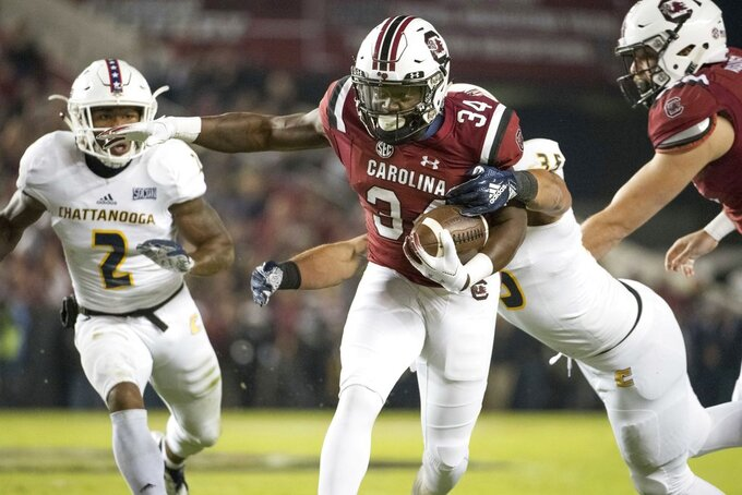 South Carolina running back Mon Denson (34) carries the ball against Chattanooga linebacker Michael Bean (35) during the first half of an NCAA college football game Saturday, Nov. 17, 2018, in Columbia, S.C. (AP Photo/Sean Rayford)