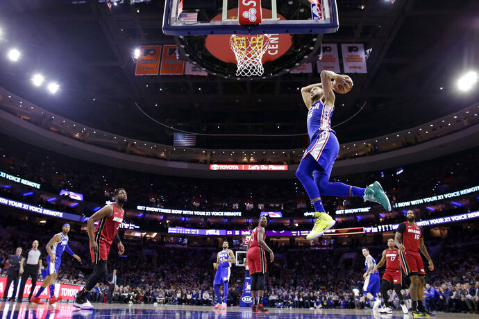Philadelphia 76ers' Ben Simmons goes up for a dunk during the first half of the team's NBA basketball game against the Miami Heat, Thursday, Feb. 21, 2019, in Philadelphia. (AP Photo/Matt Slocum)
