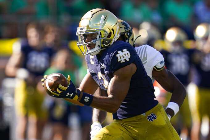 Notre Dame wide receiver Avery Davis (3) makes a catch on his way to a touchdown against Purdue during the second half of an NCAA college football game in South Bend, Ind., Saturday, Sept. 18, 2021. Notre Dame defeated Purdue 27-13. (AP Photo/Michael Conroy)