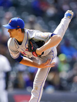 New York Mets starting pitcher Jacob deGrom works against the Colorado Rockies in the first inning in the first baseball game of a doubleheader, Saturday, April 17, 2021, in Denver.  (AP Photo/David Zalubowski)