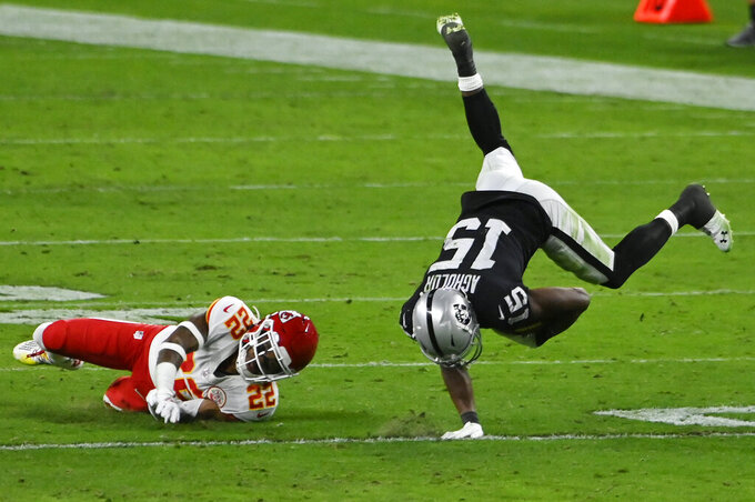 Kansas City Chiefs free safety Juan Thornhill (22) tackles Las Vegas Raiders wide receiver Nelson Agholor (15) after Agholor made a reception during the second half of an NFL football game, Sunday, Nov. 22, 2020, in Las Vegas. (AP Photo/David Becker)