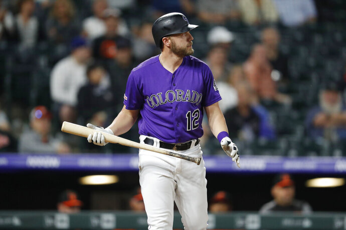 File-This May 25, 2019, file photo shows Colorado Rockies pinch-hitter Mark Reynolds reacting after striking out against Baltimore Orioles relief pitcher Josh Lucas during the ninth inning of a baseball game in Denver. Reynolds was cut by the Colorado Rockies Sunday, July 21, 2019, two home runs shy of 300 after hitting .170 with four homers and 20 RBIs in limited at-bats. He had just 135 at-bats in 78 games and was designated for assignment on Sunday in a flurry of roster moves by Colorado, which had lost 13 of its previous 15 games. A 13-year veteran, Reynolds said he will return home to assess whether or not he'd attempt to continue his playing career.  (AP Photo/David Zalubowski, File)