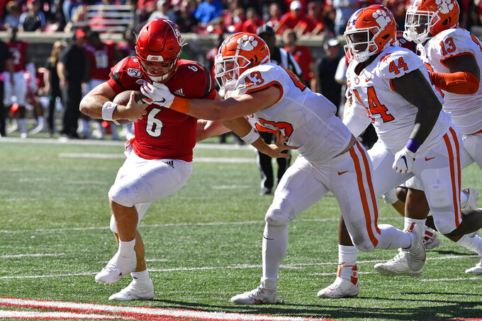 Clemson linebacker Chad Smith (43) grabs Louisville quarterback Evan Conley (6) during the first half of an NCAA college football game in Louisville, Ky., Saturday, Oct. 19, 2019. (AP Photo/Timothy D. Easley)