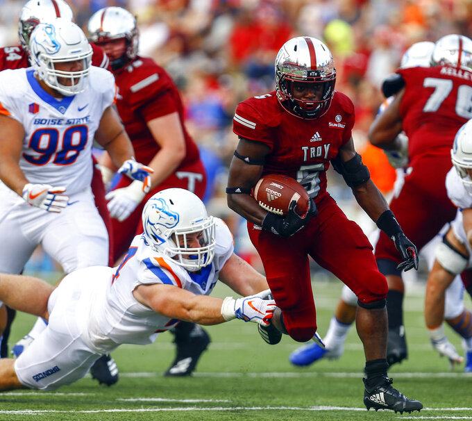 Troy running back Jabir Daughtry-Frye (5) gets past Boise State nose tackle Matt Locher and runs for a touchdown during the first half of an NCAA college football game, Saturday, Sept. 1, 2018, in Troy, Ala. (AP Photo/Butch Dill)