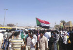 Protesters march in  Wad Madani, the provincial capital of al-Jazirah province, Sudan, Sunday, Nov. 3, 2019. Hundreds of protesters took to the streets in Sudan's capital and across the country on Sunday, demanding the disbanding of the former ruling party that underpinned Sudanese President Omar al-Bashir's three decades in power. (The Madani's Resistance Committee via AP)