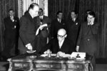 """FILE - In this April 18, 1950 file photo, French Foreign Minister Robert Schuman signs a treaty. Pope Francis has put one of the architects of the plan for European integration, a forerunner of the European Union, on the path to possible sainthood. The Vatican said on Saturday, June 19, 2021 that the pontiff authorized a decree declaring the """"heroic virtues"""" of Robert Schuman, a former French minister and Resistance fighter in World War II, who died in 1963 and who had been president of the European Parliament from 1958 till 1960. (AP Photo/1950)"""