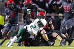 North Carolina State linebacker Drake Thomas (32) tackles South Florida running back Darrian Felix (2) during the first half of an NCAA college football game in Raleigh, N.C., Thursday, Sept. 2, 2021. (AP Photo/Gerry Broome)