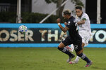 New York City defender Ronald Matarrita, left, moves the ball past Portland Timbers'Pablo Bonilla, during the first half of an MLS soccer match, Saturday, Aug. 1, 2020, in Kissimmee, Fla. (AP Photo/John Raoux)