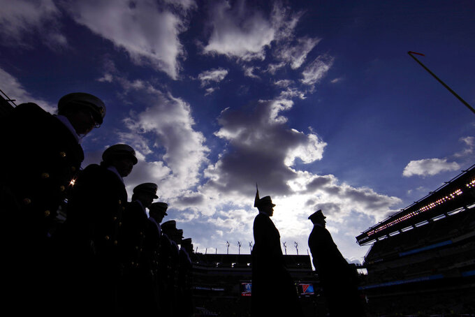 Navy Midshipmen march onto the field before an NCAA college football game against Army, Saturday, Dec. 8, 2018, in Philadelphia. (AP Photo/Matt Slocum)